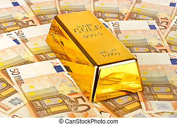Gold bar and euro money