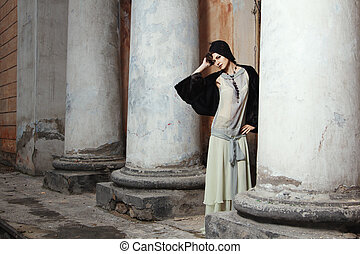 Retro styled fashion portrait of a young woman. Clothing and...