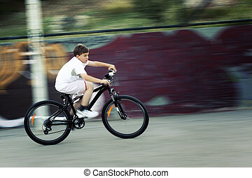 Fast bike ride - 11 years old boy caught in motion while...
