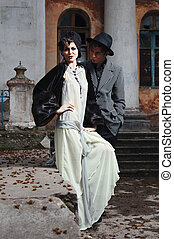 Retro styled fashion portrait of a young couple Clothing and...