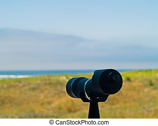 Spotting Scope Pointing to the Beach and Ocean in the...