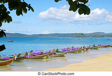 longtail boats on a tropical sea
