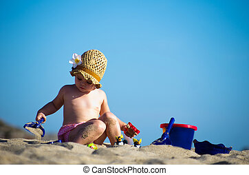 girl playing on  beach - Little girl playing on the beach