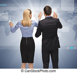 man and woman working with something imaginary - picture of...