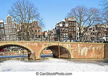 winter in Amsterdam the Netherlands with the Westerkerk -...