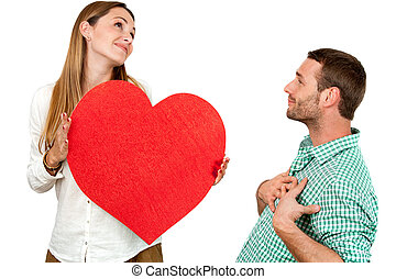 Couple fooling around with heart sign - Close up portrait of...