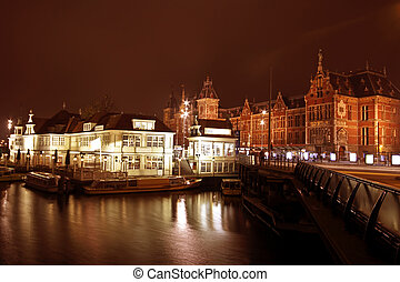 City scenic from Amsterdam with the central station at night...
