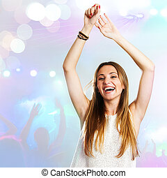 Young woman dancing with party background. - young...