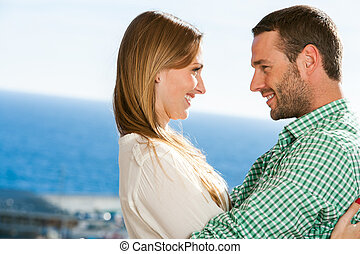Young couple embracing outdoors. - Close up portrait of...