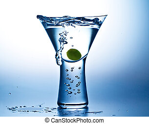 Blue Mood Martini - Gin or vodka martini with olive showing...