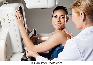 Female Undergoing Mammogram X-ray Test - Happy female...