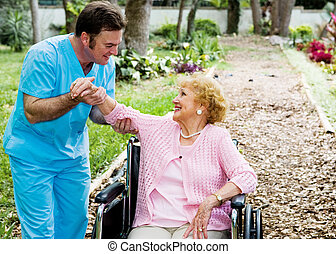 Physical Therapy - Beautiful disabled senior woman receiving...