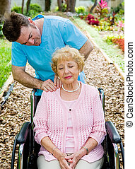 Physical Therapy - Massage - Senior woman in wheelchair...