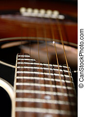 guitar 1 - a close up of an acoustic guitar