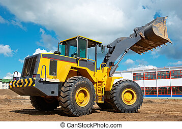 wheel loader excavator at work - heavy wheel loader...