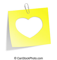 Cut heart in yellow sticker note with clip isolated on white...