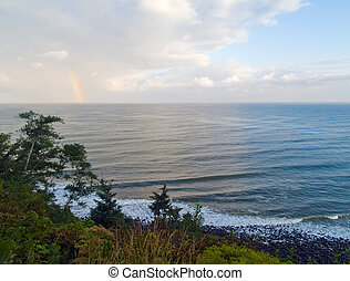 Rainbow Over the Ocean with a Partly Cloudy Sky