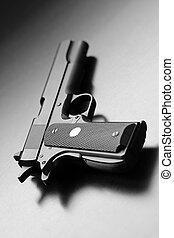 pistol - Legendary .45 caliber pistol. Studio shot. Shallow...