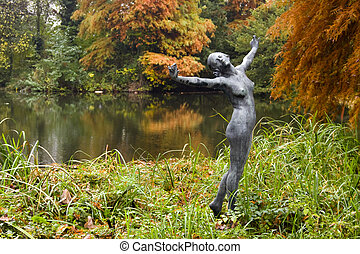 Statue in an arboretum - Statue of a girl in the Arboretum...
