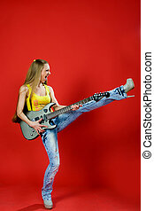 beautiful girl with a guitar screaming - beautiful girl in...
