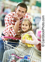 Family shopping in supermarket - Family food shopping. Young...