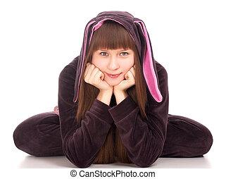 ?ute girl in rabbit costume over white background