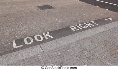Look Right London UK - Sign on road warning tourists to look...