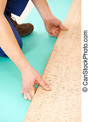 cork flooring work - Close-up process of cork boards laying...