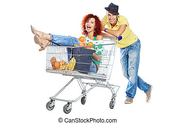 attractive couple - Cheerful couple with a shopping trolley....