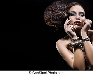 Beautiful brunette lady posing with amazing hairstyle.