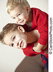 Two boys playing and embracing