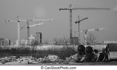 Five cranes working. Timelapse. - Cranes working at...
