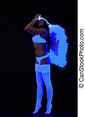 woman in sexy lingerie with wing under ultraviolet