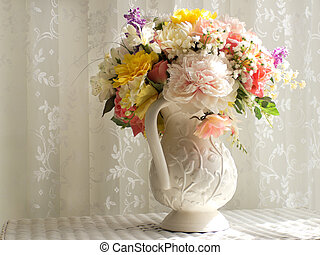 White Pitcher with Flowers - A white ceramic handled pitcher...