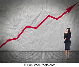 Business woman looking chart - Young woman looking chart...