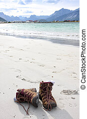 treking shoes outdoors - treking shoes standing on a coast...