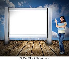 Student woman near billboard.