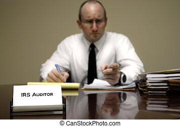 IRS Tax Auditor - IRS tax auditor man with a stern or mean...