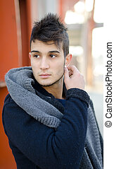Attractive young man outdoors in urban environment