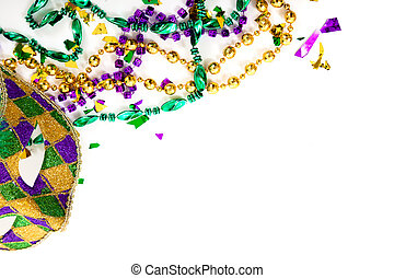 Purple, gold and green Mardi gras mask and beads on a white...