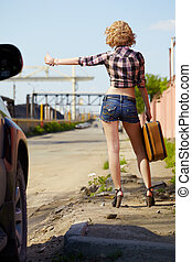 blonde girl hitchhiker - outdoor portrait of young beautiful...