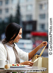 Unwrapping paper bag - Image of happy female in open air...