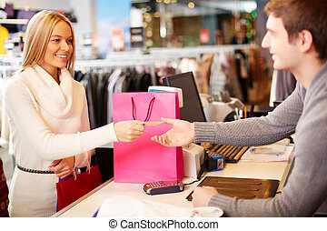 Payment - Portrait of pretty woman giving credit card to...