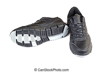 black sports shoes - closeup of black sports shoes on a...