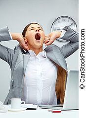 Big yawn - Tired office manager stretching herself and...