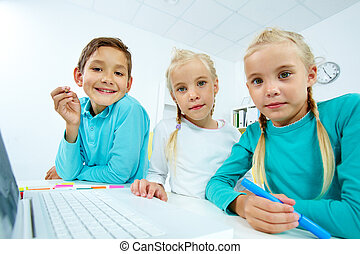 Modern pupils - Charming pupils using modern means of...