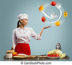 Asian woman chef juggling with vegetables