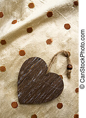 riser card, wooden heart on fabric background