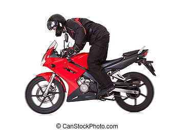 Biker standing up while riding his motorbike - Biker in...