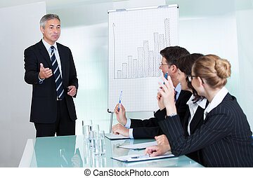 Manager giving a presentation to staff - Manager or senior...